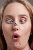 Woman surprised by fly on her nose Stock Photos