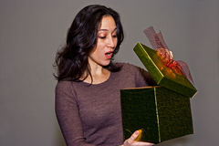 Woman surprised by gift royalty free stock photo