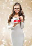Woman surprised holding a red gift box Royalty Free Stock Photography