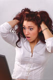 Woman with surprised look in laptop Stock Images
