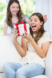 Woman surprised looking at gift given by daughter Stock Image