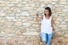 Woman surprised for the mobile Royalty Free Stock Image