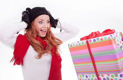Woman surprised at receiving a gift Royalty Free Stock Images
