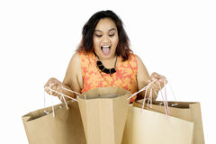 Woman surprised with shopping bag Stock Image