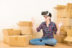 Woman surprised to experience VR headset Stock Images