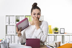 Woman is surprised to see her present and is covering her mouth Royalty Free Stock Photography