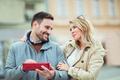 Woman surprising her boyfriend with a gift Royalty Free Stock Photo
