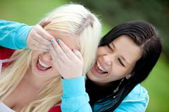Woman surprising her friend Stock Images