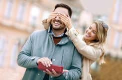 Woman surprising his boyfriend with a gift. Stock Photography