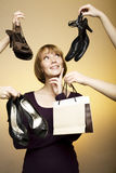 Woman surrounde by shoes bags Stock Image