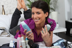 Woman surrounded by cosmetics Stock Image