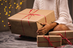 Woman surrounded by presents Stock Photo