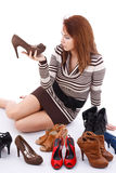 Woman surrounded by shoes Royalty Free Stock Images
