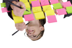 Woman surrounded by sticky notes Royalty Free Stock Photo
