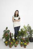 Woman Surrounded By Various Potted Plants Royalty Free Stock Photography