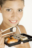 Woman with sushi Stock Photos