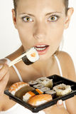 Woman with sushi. Portrait of woman with sushi Royalty Free Stock Photography