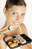 Woman with sushi Stock Images