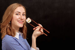 Woman with sushi Royalty Free Stock Photography