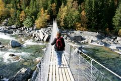 Woman on a suspension bridge Royalty Free Stock Photography