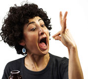 Woman swallows a pill Royalty Free Stock Photography