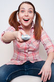 Woman swapping the TV channels Stock Photos