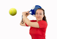 Woman swatting the ball the paddel Stock Photo