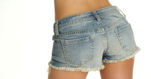 Woman swaying hips in denim shorts Royalty Free Stock Images