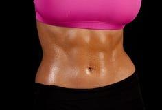 Woman sweat stomach straight Royalty Free Stock Image