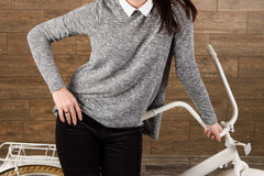 Woman in Sweater at Bicycle Royalty Free Stock Images