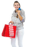 Woman in sweater with christmas shopping bag and credit card Royalty Free Stock Photography