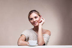 woman in sweater with cup of aromatic coffee Stock Photos