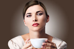 Woman in sweater with cup of aromatic coffee or tea stock photos