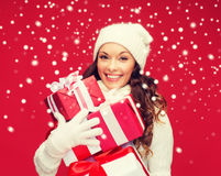 Woman in sweater and hat with many gift boxes Royalty Free Stock Photography