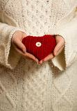 Woman in sweater holding red knitted heart Royalty Free Stock Image