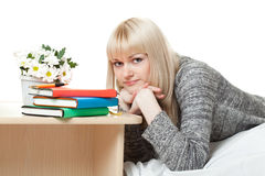 Woman in sweater near books Stock Image