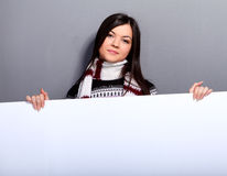 Woman in sweater with placard Royalty Free Stock Photography