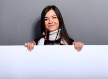 Woman in sweater with placard Stock Photos
