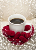 Woman in Sweater with Red Mittens Holding Cup of Coffee Royalty Free Stock Photography