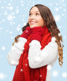 Woman in sweater, scarf and mittens Stock Photo