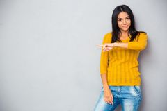 Woman in sweater showing finger away Royalty Free Stock Image