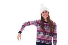 Woman in sweater and white hat holding something. Smiling young woman in purple sweater and white hat holding something on white background in studio Stock Images