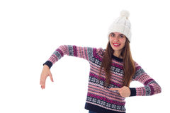 Woman in sweater and white hat holding something Stock Image