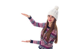 Woman in sweater and white hat holding something. Young charming woman in purple sweater and white hat holding something on white background in studio Stock Images