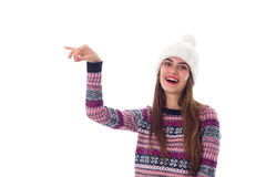 Woman in sweater and white hat holding something Royalty Free Stock Image