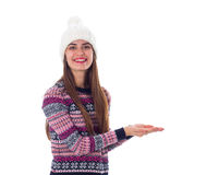Woman in sweater and white hat holding something Royalty Free Stock Photography