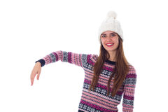 Woman in sweater and white hat holding something Royalty Free Stock Photo