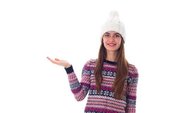 Woman in sweater and white hat holding something. Young pretty woman in purple sweater and white hat holding something on her hand on white background in studio Stock Photos