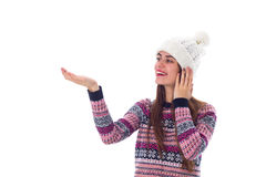 Woman in sweater and white hat holding something Stock Photo