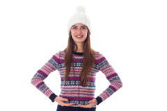 Woman in sweater and white hat holding something Stock Images